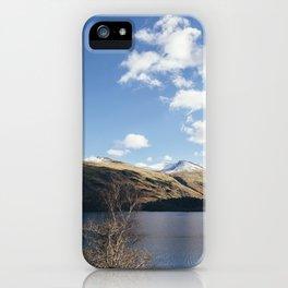 Sunlit trees on the shore of Thirlmere. Cumbria, UK. iPhone Case