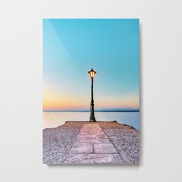 Old Vintage Lantern placed at the end of a pier over sea at sunset. Metal Print