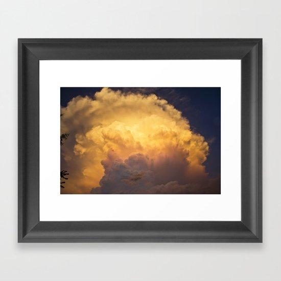 Sunset behind clouds Framed Art Print