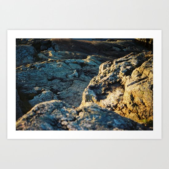 The sun is setting over the rocks Art Print