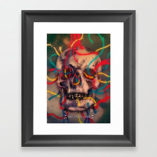 '' sad music plays '' Framed Art Print
