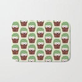 Hedgehogs disguised as cactuses Bath Mat