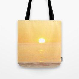 Peachy sunrise seascape Tote Bag