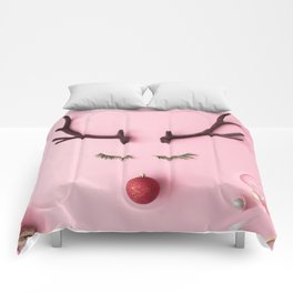 Christmas reindeer concept with presents, decoration, and winter things on pastel pink background Comforters
