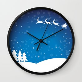Santa's sleigh ride on a blue background Wall Clock