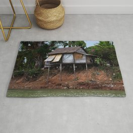 Picturesque Stilt house on the Mekong River Bank, Laos Rug
