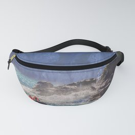 Small boat and waves crashing over rocks Fanny Pack