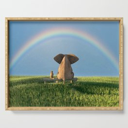 elephant and dog sitting under the rainbow on a green grass field Serving Tray