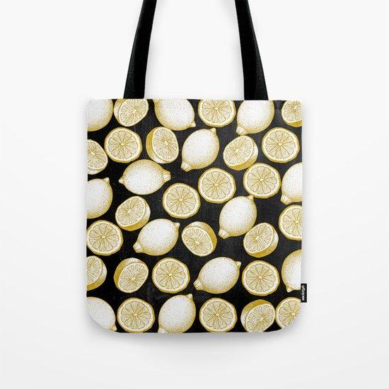 Lemons on black background Tote Bag