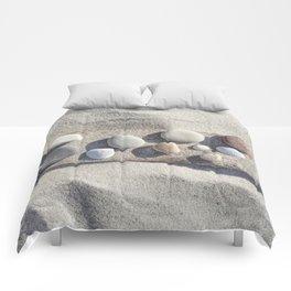Beach pebble driftwood still life Comforters