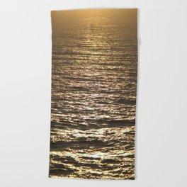 Sun ray on the sea Beach Towel