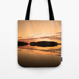 Beautiful sunset - glowing orange - forest silhouette and reflection Tote Bag