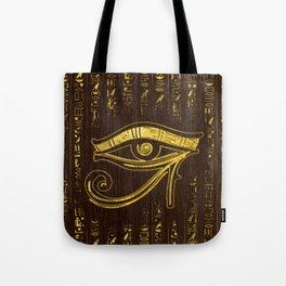 Golden Egyptian Eye of Horus  and hieroglyphics on wood Tote Bag