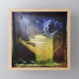 One yellow watering can with violet flowers Framed Mini Art Print