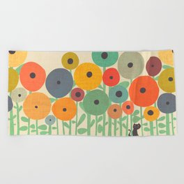 Cat in flower garden Beach Towel