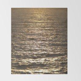 Sun ray on the sea Throw Blanket