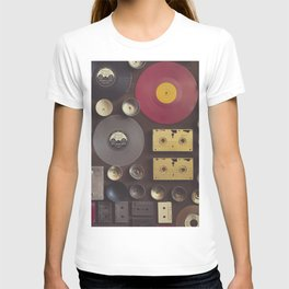 Music. Vintage wall with vinyl records and audio cassettes hung. T-shirt