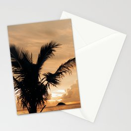 Warm cloudy sunset with palm tree silhouette Stationery Cards