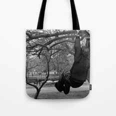 Swinging on Tree Branches Tote Bag
