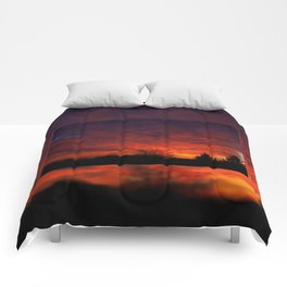 Red sunset and trees silhouette in Warsaw Comforters