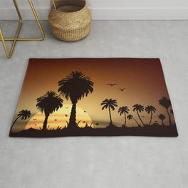 Sunsets and sunrises over the savanna with palm trees Rug