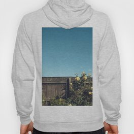 Yellow flowers over a wooden fence Hoody