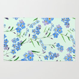 forget me not in green background Rug