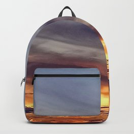 Grey clouds and yellow sunset Backpack