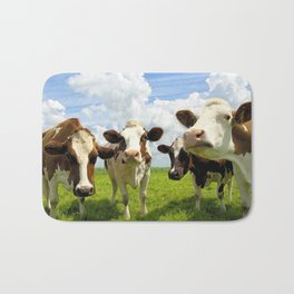 Four chatting cows Bath Mat