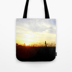 Sunset Behind the Fence Tote Bag