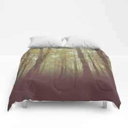 Wood in winter with fog Comforters