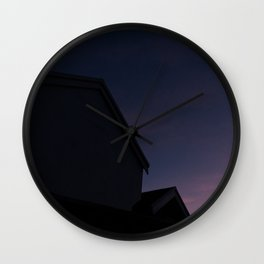 See me at sundown III Wall Clock