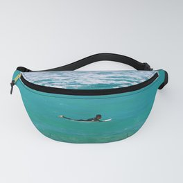 Surfer paddling to the surf at Bronte Beach. Sydney. Australia. Fanny Pack