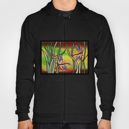 dragonflies in the grass on a colored background Hoody