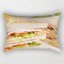Club sandwich on a rustic table in bright light Rectangular Pillow