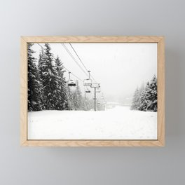 Lifts waiting for action in the snow Framed Mini Art Print
