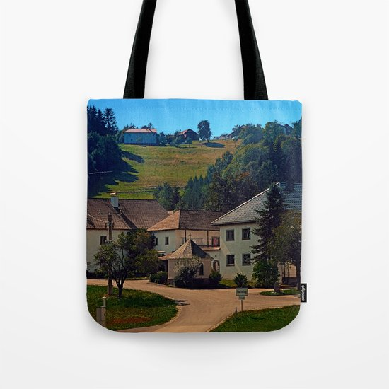 Small village in autumn scenery Tote Bag