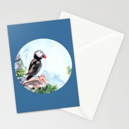 Puffin sitting on a rock with a blue background Stationery Cards