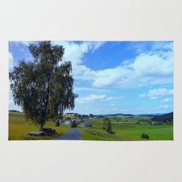 Old tree, country road and a cloudy sky | landscape photography Rug