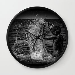 Be the wave that i am and then sink back to the ocean Wall Clock