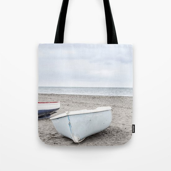 Lonely boats at the beach Tote Bag