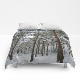 Snowy woodland Comforters