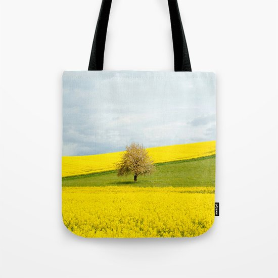 Tree in Yellow Field Tote Bag